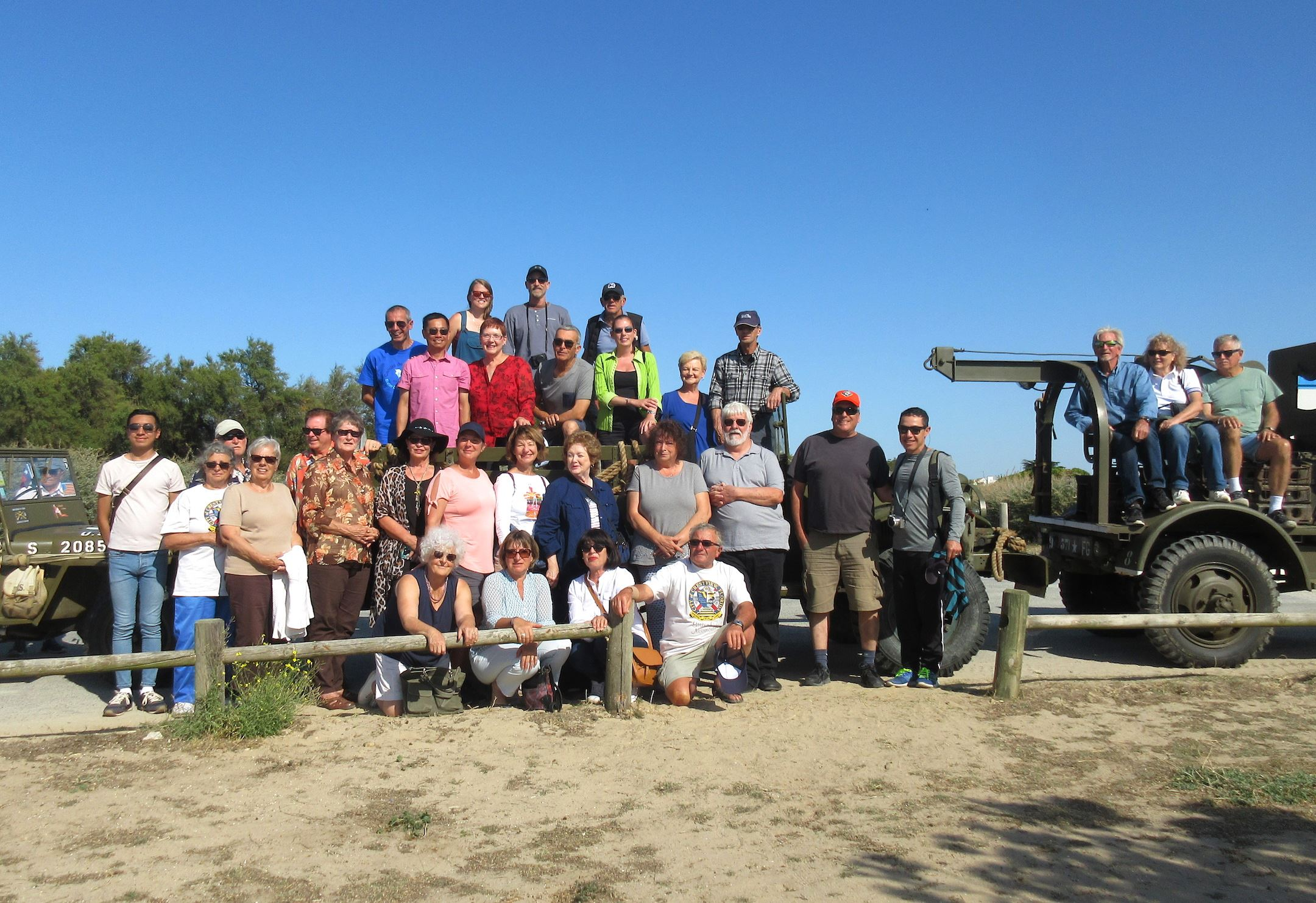 Members of the Crestview Area Sister City Program delegation to Noirmoutier pose atop World War II v