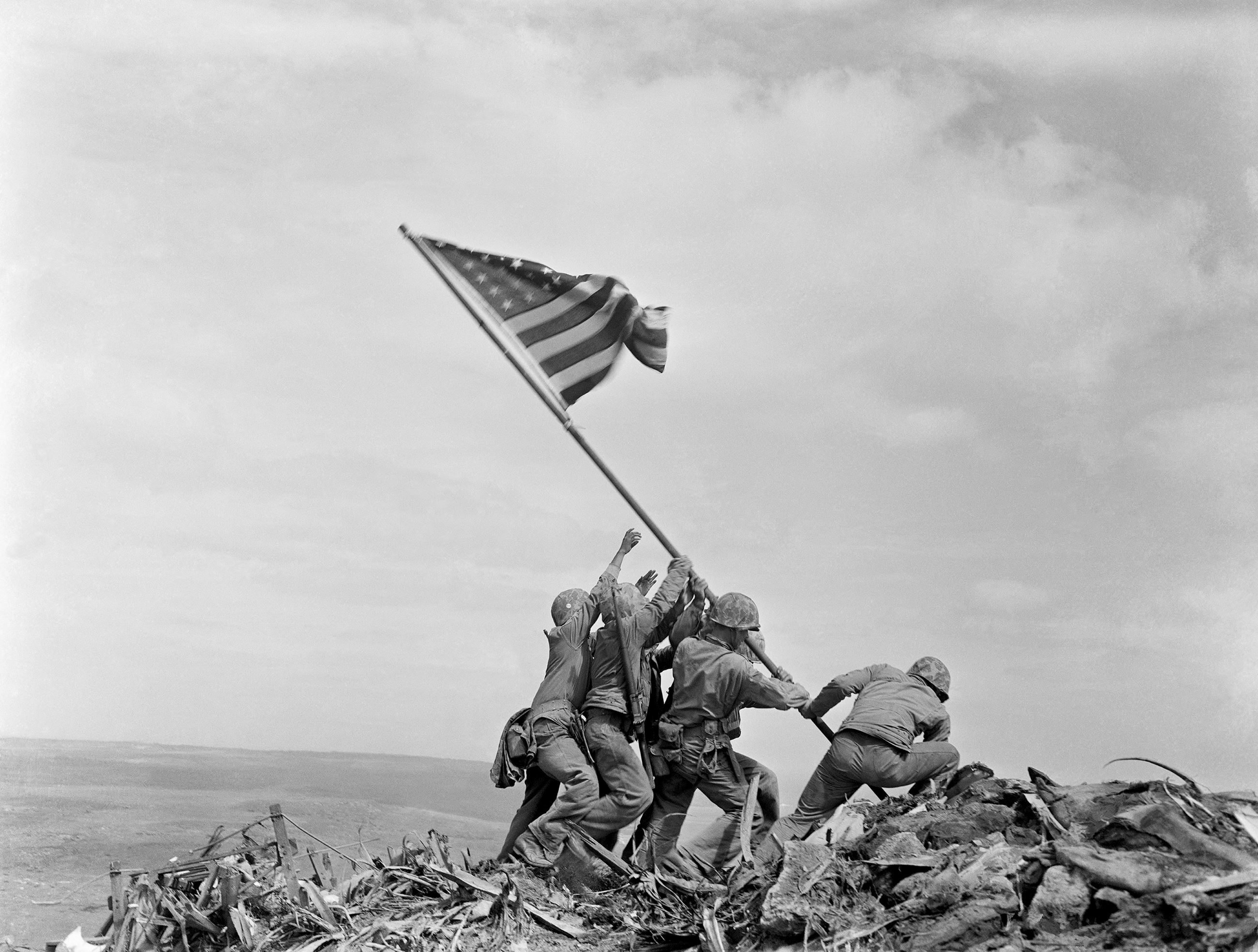 Raising the second flag on Mount Suribachi, Iwo Jima, by Joe Rosenthal, Associated Press photo