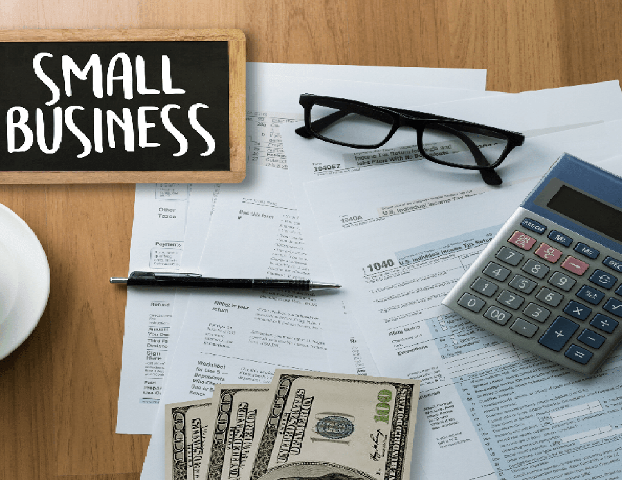 calculator, reading, glasses, pen, tax papers, text: small business