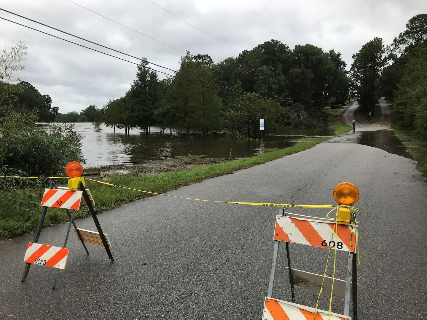 County Road Dept. barriers close off the flooded low-lying section of Grandview Drive Wednesday.