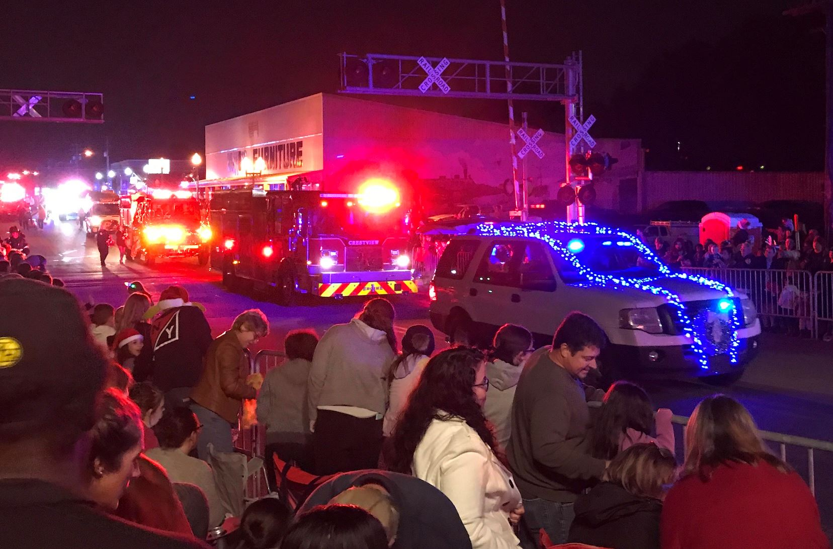 Flashing first responder vehicle lights add dazzle to the 2019 Main Street Christmas parade