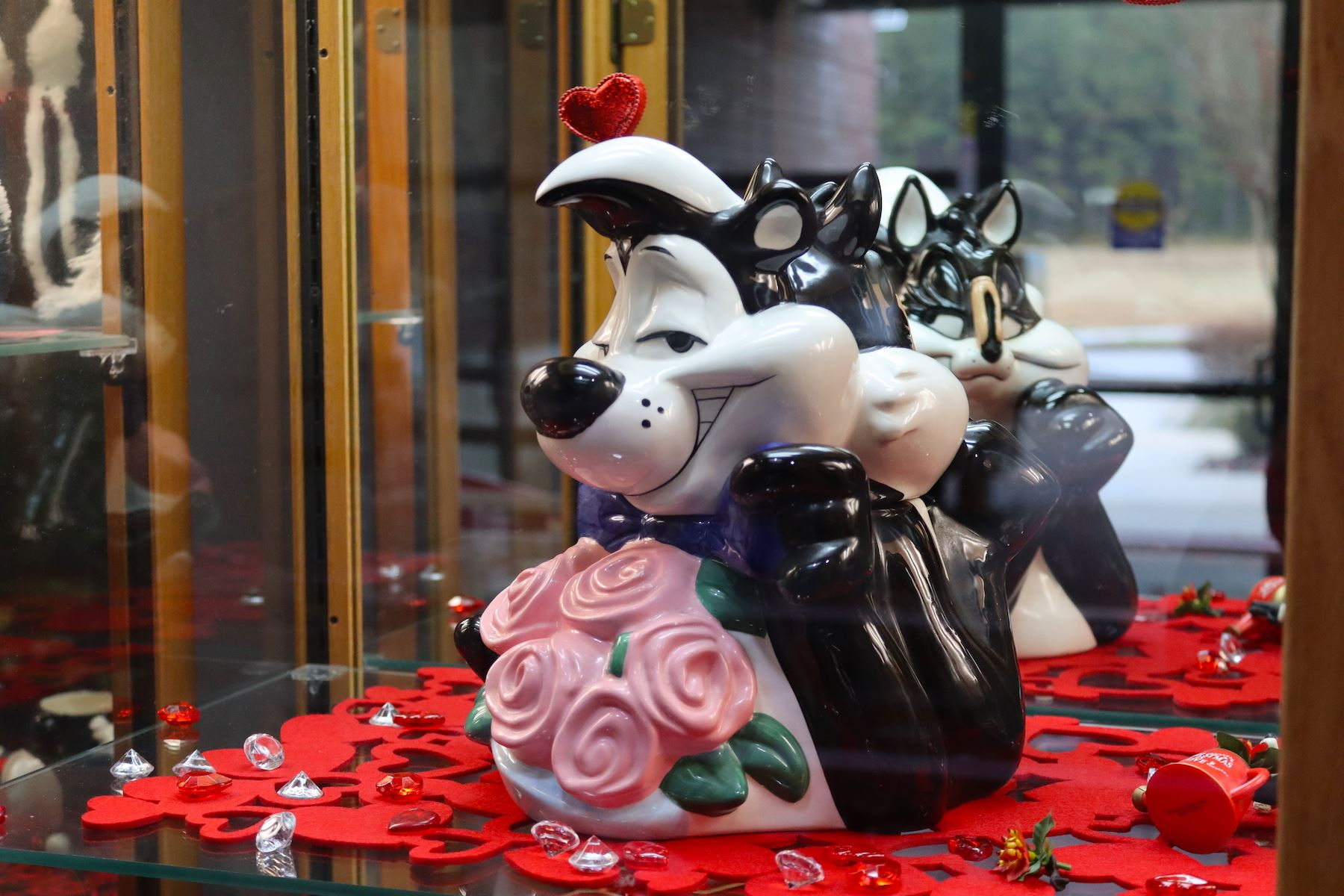 The Warner Bros. lovelorn cartoon skunk, Pepé Le Pew, is seen with a bunch of roses.