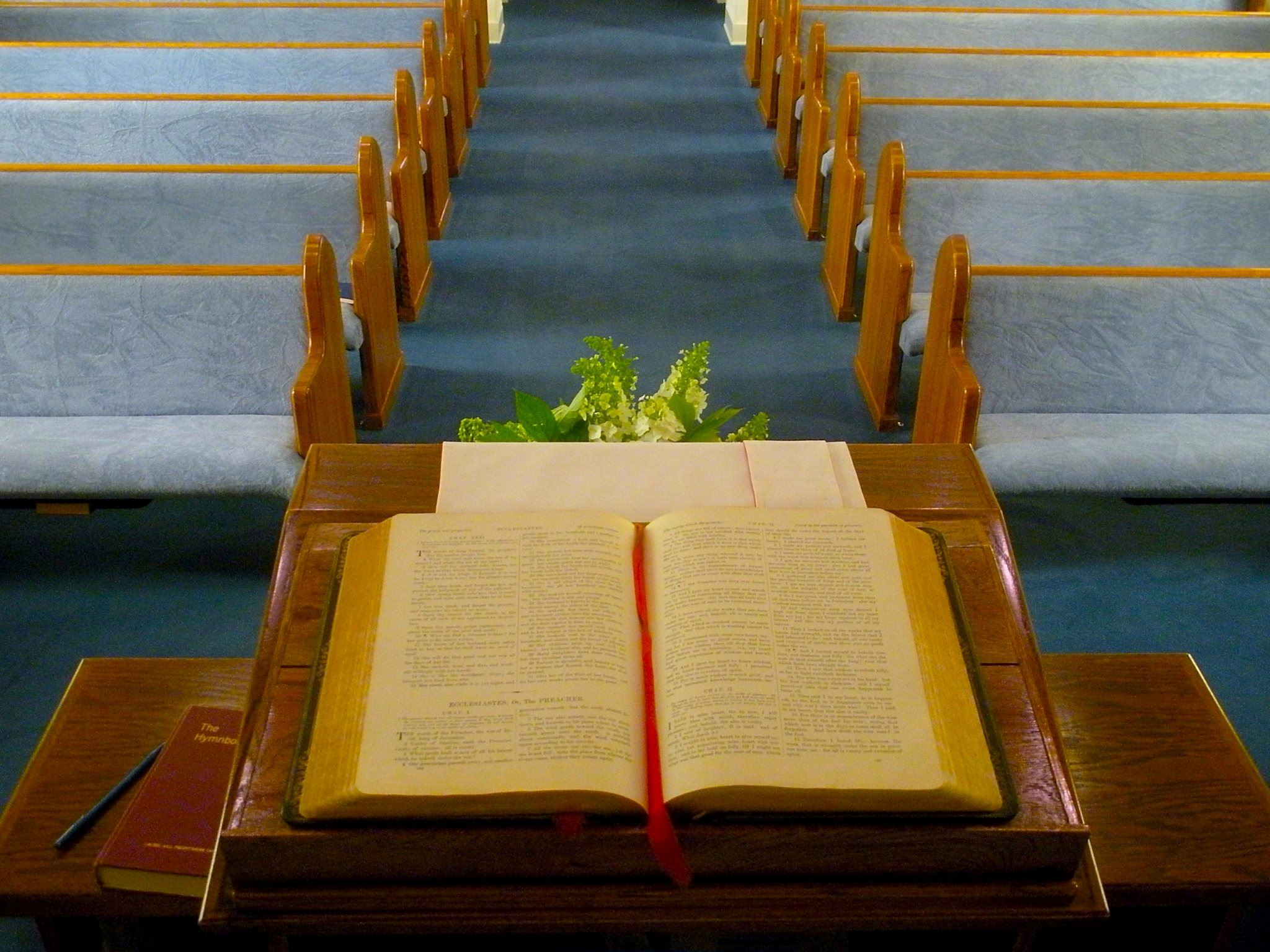A Bible lies open on a local church's pulpit.